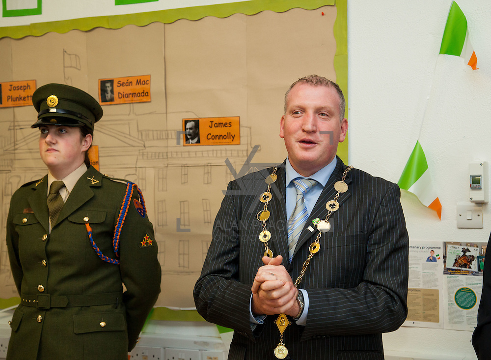 23/10/2015       <br /> Members of the Defence Forces were in Abbeyfeale today to present a handmade Tricolour and a copy of the Proclamation of the Irish Republic to students of the town's two primary schools.<br /> <br /> St Marys Boys National School and Scoil Mh&aacute;thair D&eacute; are among 3,000 schools nationally and 152 Limerick primary schools to receive the presentation as part of initiatives to mark the centenary of the 1916 Rising.&nbsp;<br /> <br /> Councillor Liam Galvin, Mayor of the City and County of Limerick joined pupils and teachers for today's presentation ceremony, which saw representatives of the Defences Forces raise the flag and read the Proclamation. <br /> <br /> Attending the ceremony at St. Marys Boys National School were, Private Ciara Quinn and Mayor of Limerick Cllr. Liam Galvin. Picture: Alan Place.