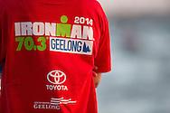 Volenteer at swim start, February 9, 2014 - Triathlon : Geelong Ironman 70.3, Eastern Beach Precinct, Geelong, Victoria, Australia. Credit: Lucas Wroe