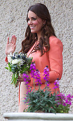 WINCHESTER-ENGLAND-29-APR-2013- The Duchess of Cambridge visits Naomi House Children's Hospice, Hampshire, to celebrate Children's Hospice Week 2013. Kate toured the Hospice's facilities, where she met children and their families, as well as staff, volunteers and supporters of the charity.  .Photograph by Ian Jones