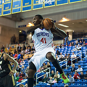 "Delaware 87ers Forward Keith ""Tiny"" Gallon (41) grabs a defensive rebound in the first half of a NBA D-league regular season basketball game between Delaware 87ers (76ers) and the Erie BayHawks (Knicks) Friday, Jan. 3, 2014 at The Bob Carpenter Sports Convocation Center, Newark, DE"