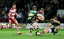 Ross Moriarty of Gloucester Rugby charges Harry Mallinder of Northampton Saints to the ball but is tackled by Jamie Gibson of Northampton Saints - Mandatory by-line: Robbie Stephenson/JMP - 28/10/2016 - RUGBY - Franklin's Gardens - Northampton, England - Northampton Saints v Gloucester Rugby - Aviva Premiership