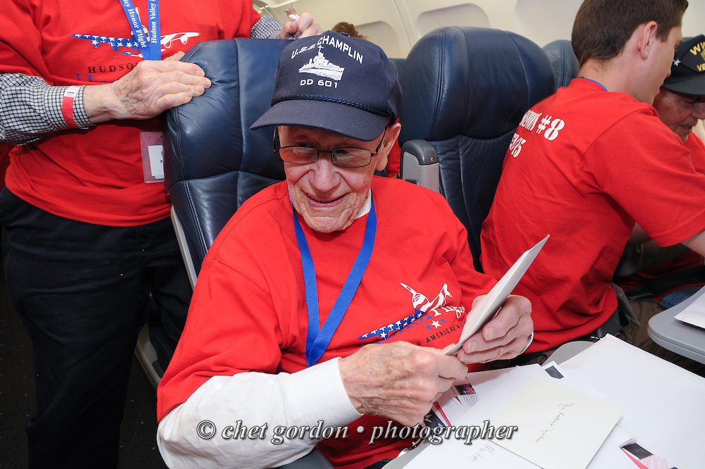 WWII Veterans and their escorts onboard the Hudson Valley Honor Flight depart Reagan National Airport in Arlington, VA on Saturday, May 9, 2015. Sixty-six veterans from the Westchester County (NY) area toured the WWII and Marine Corps War Memorials, as well as Arlington National Cemetery. Hudson Valley Honor Flight is a chapter of the Honor Flight Network, which provides free flights for WWII Veterans and tours of the WWII Memorial constructed in their honor, and other sites in the nation's capital.  © Chet Gordon / Hudson Valley Honor Flight