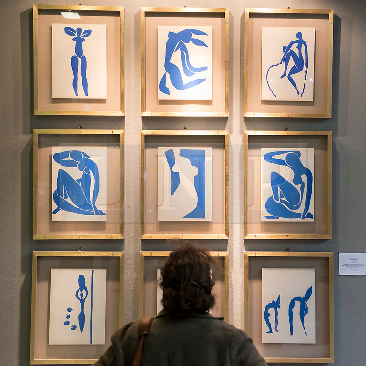 © Licensed to London News Pictures. 20/06/2018. LONDON, UK. A visitor views coloured lithographs derived from original maquettes by Henri Matsisse at The Art & Antiques Fair Olympia which runs 20 to 27 June at Kensington Olympia.  Photo credit: Stephen Chung/LNP