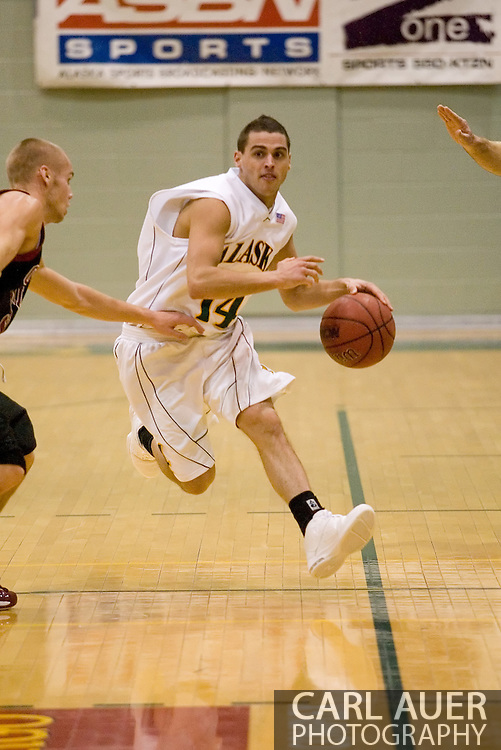 1/6/2006: Junior guard Luke Cooper (14) of the UAA Seawolves as Anchorage goes on the beat the visiting Central Washington Wildcats, 80-60 at the Wells Fargo Sports Complex on the campus of UAA.<br />