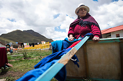 Luisa Cruz is one of the new residents of Carhuacoto, a town built by Chinese mining company Chinalco to relocate the residents of Morococha in the central Peruvian Andes.