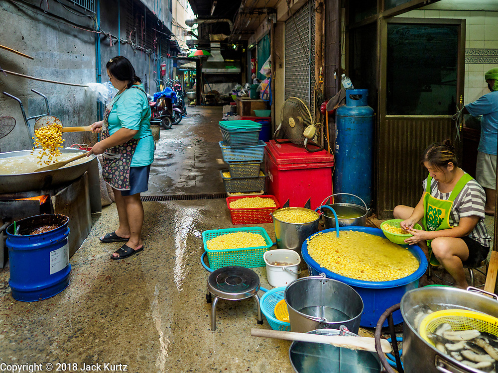 """07 FEBRUARY 2018 - BANGKOK, THAILAND:  Women in Bangkok's """"Chinatown""""  propare boiled mung beans used in desserts consumed during Lunar New Year celebrations. The Lunar New Year, also called Tet or Chinese New Year, is 16 February this year. The coming year will be the Year of the Dog. Thailand has a large Chinese community and Lunar New Year is widely celebrated in Thailand, especially in Bangkok and large cities with significant Chinese communities.     PHOTO BY JACK KURTZ"""