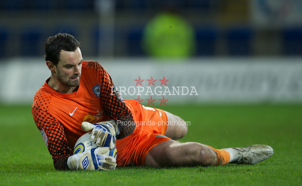 CARDIFF, WALES - Tuesday, February 14, 2012: Peterborough United's goalkeeper Joe Lewis in action against Cardiff City during the Football League Championship match at the Cardiff City Stadium. (Pic by David Rawcliffe/Propaganda)