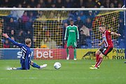 AFC Wimbledon midfielder Mitchell (Mitch) Pinnock (11) performing a sliding tackle during the EFL Sky Bet League 1 match between AFC Wimbledon and Lincoln City at the Cherry Red Records Stadium, Kingston, England on 2 November 2019.