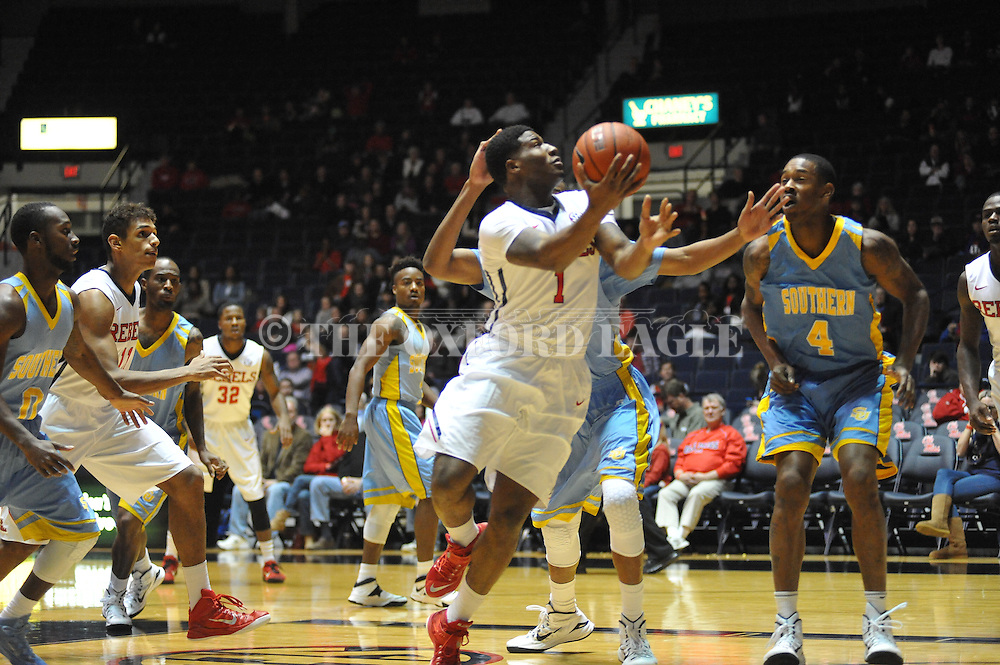 """Ole Miss guard Martavious Newby (1) vs. Southern at the C.M. """"Tad"""" Smith Coliseum in Oxford, Miss. on Thursday, November 20, 2014. (AP Photo/Oxford Eagle, Bruce Newman)"""