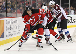 Mar 15; Newark, NJ, USA; New Jersey Devils right wing David Clarkson (23) plays the puck while being defended by Colorado Avalanche defenseman Matt Hunwick (22) during the second period at the Prudential Center.