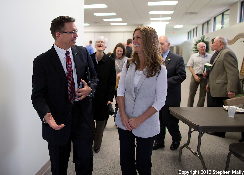 Rep. Bobby Schilling (R-Ill) and his wife, Christie, share a laugh as they leave an event at the Moline Rotary Club held at Christ The King Parish in Moline, Illinois on Monday, April 30, 2012.