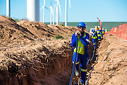 Laying the electric cable from the wind turbines to the substation