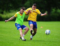 Bristol Rovers' Ollie Clarke clears the ball under pressure from Oliver Norburn - Photo mandatory by-line: Dougie Allward/JMP - Tel: Mobile: 07966 386802 24/06/2013 - SPORT - FOOTBALL - Bristol -  Bristol Rovers - Pre Season Training - Npower League Two