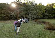 Salisbury Mills, New York - A group of people hike through Clove Brook Farm at the base of Schunnemunk Mountain on Oct. 2, 2010. The outing was organized by the Hudson Highlands Nature Museum. The land will be preserved because the owners donated the development rights to the 183-acre 18th-century farm to the Orange County Land Trust in 2001.