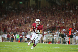 September 26, 2009; Stanford, CA, USA; Stanford Cardinal quarterback Andrew Luck (12) rushes up field for a touchdown against the Washington Huskies during the third quarter at Stanford Stadium. Stanford defeated Washington 34-14. Mandatory Credit: Jason O. Watson-US PRESSWIRE