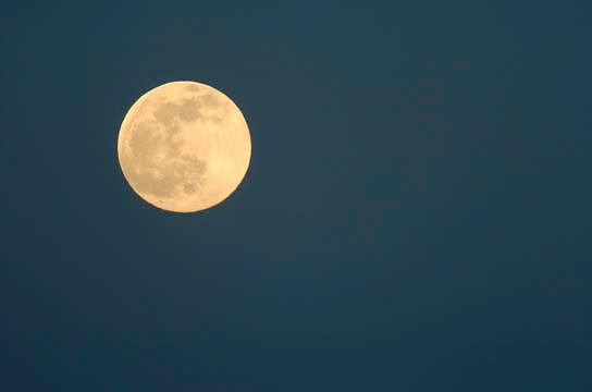 Full  moon in dark Montana sky.