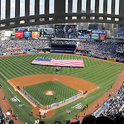 A general view to a packed Yankee Stadium during the New York Yankees opening day of the Major League Baseball 2013 season during the New York Yankees V Boston Red Sox American League East baseball game at Yankee Stadium, The Bronx, New York. USA, 1st April 2013. Photo Tim Clayton.Note to Editors. This image is a composite to two images taken a split second apart and merged in editing.