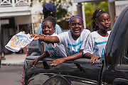 Young Bahamian girls celebrate graduation in Nassau , Bahamas.