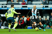 Jonjo Shelvey (#8) of Newcastle United takes on Lewis Cook (#16) of AFC Bournemouth during the Premier League match between Newcastle United and Bournemouth at St. James's Park, Newcastle, England on 9 November 2019.