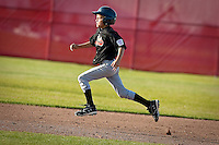 JEROME A. POLLOS/Press..Zach Hillman, from the Post Falls All Stars, races to third base after an error by North Boise during Friday's game at Croffoot Park in Hayden.