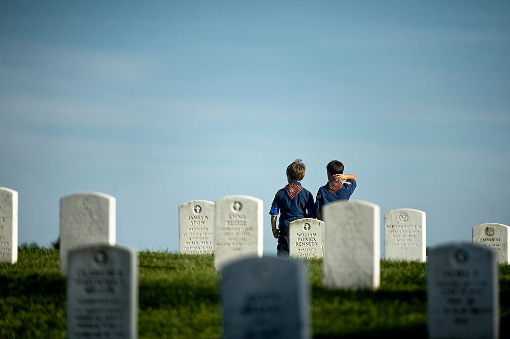 "(staff photo by Matt Roth)..Members of cub scout pack 461 Mark Mansfield, 8, from Ellicott City, left, and Kobi Fouts, 8, from Columbia go to a hill crest to take-in the expanse of the Baltimore National Cemetery. ""It's just sorta sad seeing how many people died,"" said Mansfield. Hundreds of cub and boy scouts from the area volunteered their time Friday, May 22, 2009 to place small American flags in front of the more than 44,000 grave sites as a way to start Memorial Day weekend...."