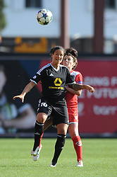FFC Frankfurt's Dzsenifer Marozsan and Bristol Academy's Angharad James jostle for the ball - Photo mandatory by-line: Dougie Allward/JMP - Mobile: 07966 386802 - 21/03/2015 - SPORT - Football - Bristol - Ashton Gate Stadium - Bristol Academy v FFC Frankfurt - UEFA Women's Champions League - Quarter Final - First Leg