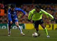 Photo: Alan Crowhurst.<br />Chelsea v Barcelona. UEFA Champions League. 22/02/2006.<br />Barcelona's Ronaldinho (R) takes Paulo Ferreira.