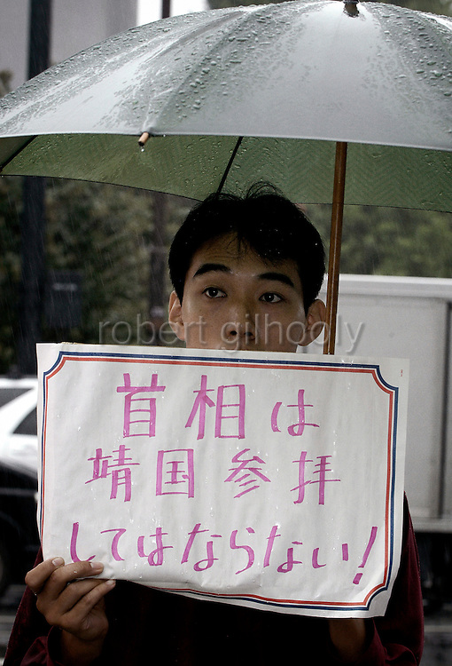 A man stands in protest of a proposed visit to controversial Yasukuni Shrine by Japan's prime minister in Tokyo, Japan. very year on August 15, the day Japan officially surrendered in WWII, tens of thousands of Japanese visit the controversial shrine to pay their respects to the 2.46 million war dead enshrined there, the majority of which are soldiers and others killed in WWII and including 14 Class A convicted war criminals, such as Japan's war-time prime minister Hideki Tojo. Each year speculation escalates as to whether the country's political leaders will visit the shrine, the last to do so being Junichiro Koizumi in 2005. Nationalism in Japan is reportedly on the rise, while sentiment against the nation by countries that suffered from Japan's wartime brutality, such as China, has been further aggravated by Japan's insistence on glossing over its wartime atrocities in school text books...Photographer:Robert Gilhooly..