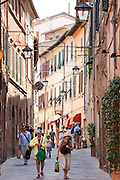 Street scene in ancient hill town of Montalcino in Val D'Orcia, Tuscany, Italy