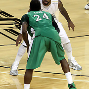 Central Florida guard Marcus Jordan (5) defends against Marshall guard DeAndre Kane (24) during a Conference USA NCAA basketball game between the Marshall Thundering Herd and the Central Florida Knights at the UCF Arena on January 5, 2011 in Orlando, Florida. Central Florida won the game 65-58 and extended their record to 14-0.  (AP Photo/Alex Menendez)