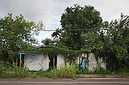 June 13, 2015, New Orleans, LA, Blighted vine covered store in mid-city.<br /> Properties destroyed by Hurricane Katrina, remain scattered around New Orleans nearly ten years after the storm.