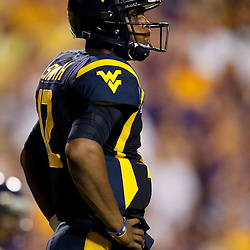 Sep 25, 2010; Baton Rouge, LA, USA; West Virginia Mountaineers quarterback Geno Smith (12) on the field against the LSU Tigers during the second half at Tiger Stadium. LSU defeated West Virginia 20-14.  Mandatory Credit: Derick E. Hingle