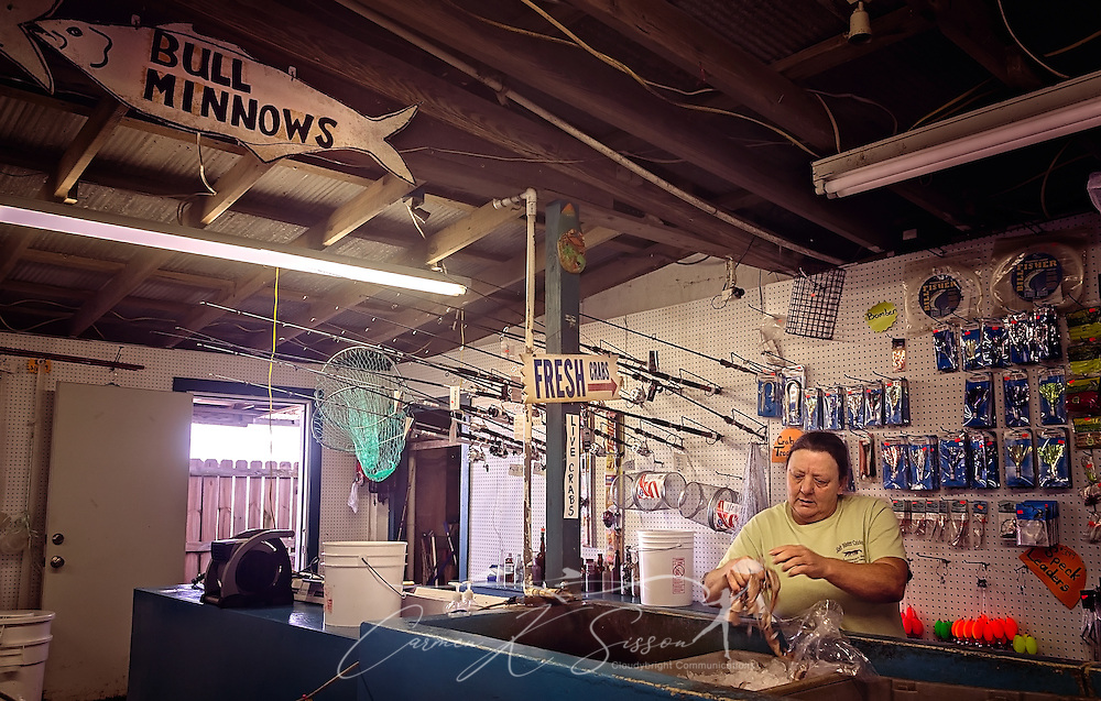 Annette Richey places squid in a bag for a customer at Jemison's Bait-N-Tackle, January 3, 2017, in Coden, Alabama. The bait shop opened in  the 1940's and is a popular stop for anglers heading to nearby Dauphin Island. (Photo by Carmen K. Sisson/Cloudybright)