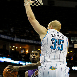 February 6, 2012; New Orleans, LA, USA; Sacramento Kings point guard Tyreke Evans (13) shoots as New Orleans Hornets center Chris Kaman (35) defends during the second half of a game at the New Orleans Arena. The Kings defeated the Hornets 100-92.  Mandatory Credit: Derick E. Hingle-US PRESSWIRE