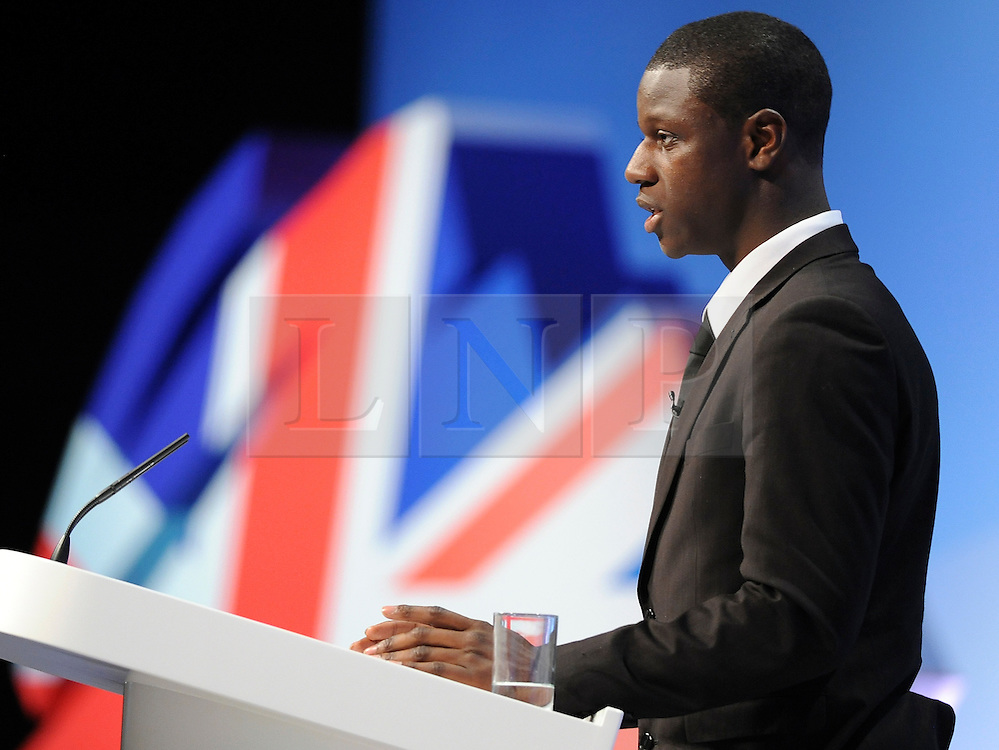© Licensed to London News Pictures. 04/10/2011. MANCHESTER. UK. Quddus Akinwale, a Year 13 Pupil at Burlington Danes Academy, addresses the conference. The Conservative Party Conference at Manchester Central today, October 4, 2011. Photo credit:  Stephen Simpson/LNP