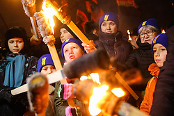 January 1, 2018 - Kiev, Ukraine - People lit the torches to start the march. Supporters and members of different far right nationalistic movements and parties participate an annual torch march downtown Kyiv confined to the 109th birthday of Ukrainian nationalism ideologist and insurgent army commander Stepan Bandera, Kyiv, Ukraine, Jan.1, 2018. (Credit Image: © Sergii Kharchenko/NurPhoto via ZUMA Press)