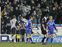 Photo: Lee Earle.<br /> Millwall v Everton. The FA Cup. 07/01/2006. The Millwall players look dejected (R) as Everton players congratulate Leon Osman (L) on his equalising goal.