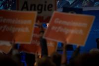 """21 SEP 2013, BERLIN/GERMANY:<br /> Angela Merkel (M), CDU, Bundeskanzlerin, waehernd ihrer Rede, im Vordergrund halten CDU Anhaenger Schilder """"Gemeinsam erfolgreich"""" und """"Angie"""" hoch, Wahlkampfabschlussvernastaltung zur Bundestagswahl 2013, Tempodrom<br /> IMAGE: 20130921-01-020<br /> KEYWORDS: Wahlkampf, Veranstaltung, Parteimitglieder, Schilder"""