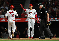 May 3, 2018 - Anaheim, CA, U.S. - ANAHEIM, CA - MAY 03: Los Angeles Angels of Anaheim designated hitter Shohei Ohtani (17) waits for shortstop Andrelton Simmons (2) at the plate after both scored on a hit in the fourth inning of a game against the Baltimore Orioles played on May 3, 2018 at Angel Stadium of Anaheim in Anaheim, CA. (Photo by John Cordes/Icon Sportswire) (Credit Image: © John Cordes/Icon SMI via ZUMA Press)