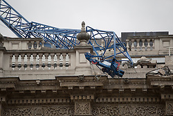 © licensed to London News Pictures. London, UK 28/10/2013. A crane has collapsed on the cabinet office in Westminster, London after the St Jude's Day Storm battered the capital with high winds and driving rain on Monday, 28 October 2013. Photo credit: Tolga Akmen/LNP