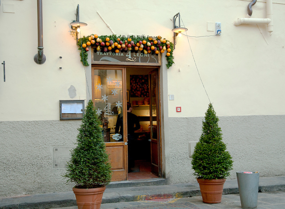 Exterior: trattoria Quatro Leone, Oltrarno, Firenze.  The door stands invitingly open.  The food is delicious.  It is frequented by neighborhood residents.