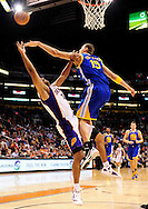Feb. 22, 2012; Phoenix, AZ, USA; Phoenix Suns forward Jared Dudley (3)is fouled by the Golden State Warriors center Andris Biedrins (15) during the first half at the US Airways Center. Mandatory Credit: Jennifer Stewart-US PRESSWIRE..