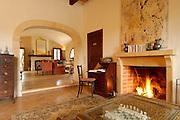 Spanien Spain,Mallorca Balearen..Arta..Finca El Encinar, innen mit Kaminfeuer..holiday finca El Encinar, open fire in fireplace....