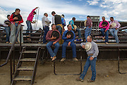 Cowboys hold hats over their hearts while the national anthem plays during the National High School Rodeo Finals at the Sweetwater Events Complex in Rock Springs, Wy on Wednesday, July 18, 2012.
