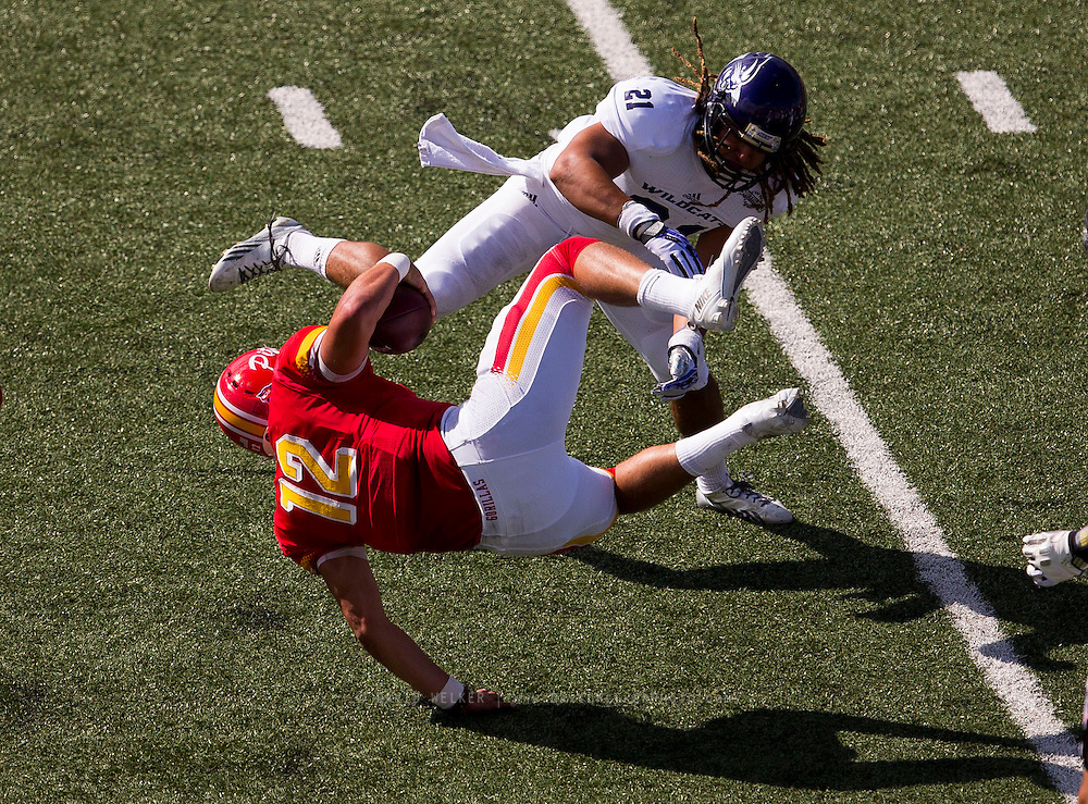 Angel Lopez (21) of the Abilene Christian Wildcats lays a hit on Anthony Abenoja (12) of the Pittsburg State Gorillas during Saturday's football game at Carnie Smith Stadium on October 5, 2013 in Pittsburg, Kansas. (David Welker)