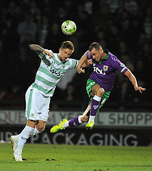 Yeovil Town's Byron Webster challenges for the high ball with Bristol City's Aaron Wilbraham - Photo mandatory by-line: Harry Trump/JMP - Mobile: 07966 386802 - 10/03/15 - SPORT - Football - Sky Bet League One - Yeovil Town v Bristol City - Huish Park, Yeovil, England.