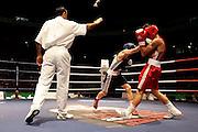 Milan, 02-09-2009 ITALY - Aiba World Boxing Championship Milan 2009.  Bantam 54 kg preliminaries..Pictured: Chygayev Georgiy UKR red vs Abzalimov Eduard RUS blue.Photo by Giovanni Marino/OTNPhotos . Obligatory Credit