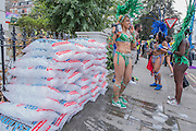 Bags of ice laying unatended on a street corner - Crowds flock to see the 50th Notting hill carnival on Bank Holiday Monday.