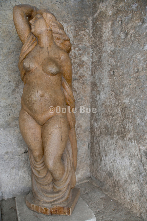 wooden sculpture of a female nude