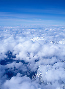 Cumulus clouds over mountain peaks